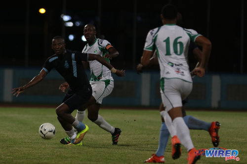 Photo: Police FC forward Jamal Perry (far left) keeps his eye on the ball while W Connection defender Daneil Cyrus (second from left) keeps an eye on him during Pro Bowl quarterfinal action at the Ato Boldon Stadium on 10 May 2016. Perry scored once but Connection won 4-3. (Courtesy Chevaughn Christopher/Wired868)
