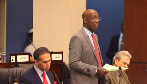 Photo: Trinidad and Tobago Prime Minister Dr Keith Rowley (centre) speaks in Parliament flanked by acting Prime Minister Colm Imbert (right) and Attorney General Faris Al-Rawi.. The country's fate, the behaviour of many suggests, is in their hands. (Copyright Parliament.Org)