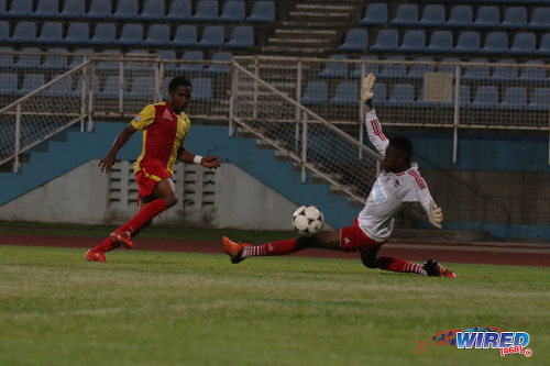 Photo: North East Stars winger Anthony Guppy (left) strokes the ball past Central FC goalkeeper Javon Sample during Pro Bowl quarterfinal action at the Ato Boldon Stadium on 10 May 2016. Stars won 2-1. (Courtesy Chevaughn Christopher/Wired868)