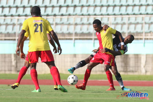 Photo: Central FC captain Leston Paul (background) tries to steal the ball from North East Stars midfielder Anthony Guppy during Pro League action at the Mannie Ramjohn Stadium on 8 May 2016. Central won 4-0 to retain the Pro League title. (Courtesy Chevaughn Christopher/Wired868)