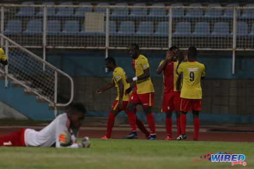 Photo: North East Stars players celebrate their opening goal from Anthony Guppy during their Pro Bowl quarterfinal round clash with Central FC at the Ato Boldon Stadium on 10 May 2016. Looking on is crestfallen Central FC goalkeeper Javon Sample (far left). (Courtesy Chevaughn Christopher/Wired868)