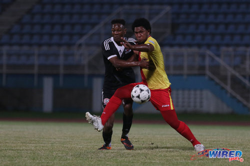 Photo: North East Stars midfielder Jean-Luc Rochford (right) tries to hold off Central FC forward Ricardo John during Pro Bowl quarterfinal action at the Ato Boldon Stadium on 10 May 2016. Stars won 2-1. (Courtesy Chevaughn Christopher/Wired868)