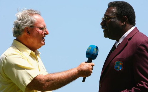 Photo: Legendary late West Indies cricket commentator Tony Cozier (left) interviews then West Indies cricket manager Clive Lloyd. (Copyright UK Telegraph)
