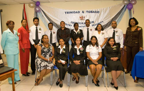 Photo: Immigration officers at their graduation ceremony with acting Deputy Chief Immigration Officer Veronica Ann King (far left), acting Deputy PS Destra Bascomber (second from left) and PS Jennifer Boucaud-Blake (far right) on 9 October 2009. (Copyright Immigration.Gov.TT)