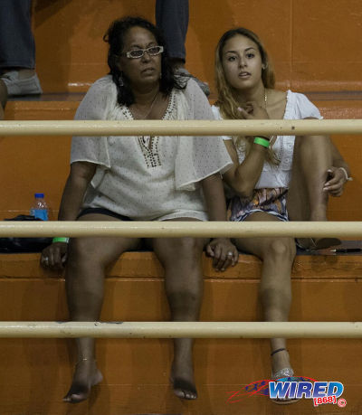 Photo: Trinidad and Tobago gymnast Marisa Dick (right) and her mother Hannifer Dick (centre) look on at a local gymnastics meet at the Tacarigua Indoor Sporting Facility on 23 April 2016. (Courtesy Wired868)