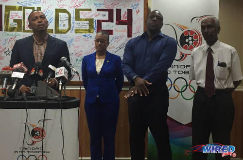Photo: Trinidad and Tobago Olympic Committee (TTOC) president Brian Lewis (far left) and games committee members (from right) Dr Terrence Ali, Ian Hypolite and Diane Henderson announce their decision to select gymnast Marisa Dick on their contingent for the Rio 2016 Olympic Games on 2 May 2016. Missing from the photograph is games committee member Annette Knott who was abroad. (Courtesy Wired868)