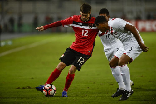 Photo: Trinidad and Tobago midfielder Sean De Silva (left) takes on Peru midfielder Adan Balbin during a friendly international match at the National stadium in Lima on 23 May 2016.  Peru won 4-0. (Copyright Ernesto Benavides/AFP 2016)