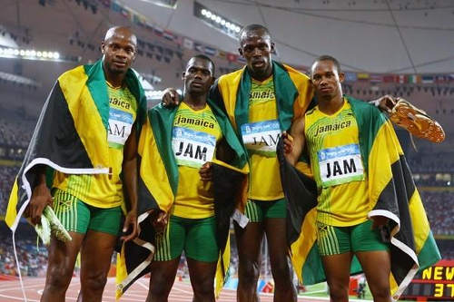 Photo: Jamaica 4x100 Beijing Olympic Games team (from left) Asafa Powell, Nesta Carter, Usain Bolt and Michael Frater. (Copyright IOC/Getty)