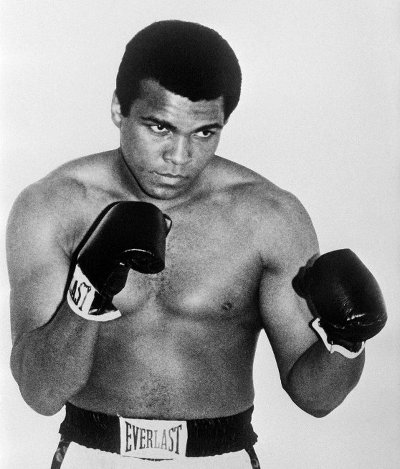 Photo: Former US boxing champion Muhammad Ali, then known as Cassius Clay, poses on 1 January 1965. Ali died on Friday 3 June 2016, at the age of 74, after a 32-year battle with Parkinson's disease. (Copyright Pigiste/AFP 2016)