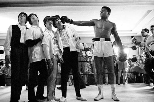 "Photo: Then world heavyweight boxing contender Cassius Clay (right) clowns around with The Beatles on 18 February 1964. The Beatles had hoped to meet reigning champion Sonny Liston and not, as John Lennon put it: ""that loudmouth who's going to lose."" Liston turned them down and they met Clay instead. Days later Clay became the heavyweight champion of the world and, later as Muhammad Ali, become one of the 20th century's most famous persons. (Copyright Harry Benson)"
