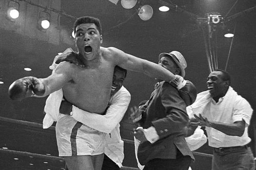 Photo: Muhammad Ali, then Cassius Clay (left), celebrates after his stunning win over Sonny Liston for the world heavyweight title. (Courtesy Bleacher Report)