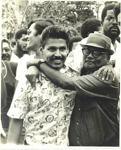 Photo: Raffique Shah (left) is greeted by his late father, Haniff Shah, on his release from prison on 27 July 1972. (Courtesy Raffique Shah)