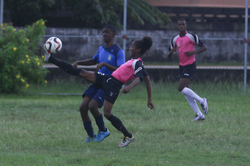 Photo: Crown Trace midfielder Dylon Roseman (right) controls the ball under pressure from a FC Santa Rosa player during Under-16 action on 11 June 2016 in the Republic Bank National Youth League. (Courtesy Chevaughn Christopher/Wired868)