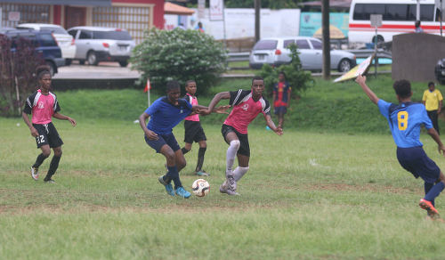 Photo: Crown Trace attacker Jevaughn Humphrey (second from right) was a handful against FC Santa Rosa in Republic Bank National Youth League action on 11 June 2016 in Macoya. Humphrey scored one and set up another as Crown Trace won 3-0 the East Zone Under-16 fixture. (Courtesy Chevaughn Christopher/All Sport)