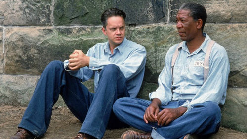 Photo: Andy Dufresne, played by the actor Tim Robbins (left), shares a moment with Red, played by Morgan Freeman, in the memorable movie, Shawshank Redemption.