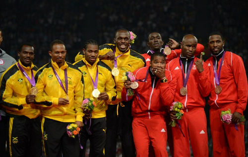 Photo: (From left) Jamaica gold medalists Michael Frater, Nesta Carter, Yohan Blake, Usain Bolt, and Trinidad and Tobago bronze medalists Keston Bledman, Marc Burns, Emmanuel Callender and Richard Thompson pose on the podium after the men's 4x100 relay final at the the London 2012 Olympic Games on 11 August 2012 in London.  The Trinidad and Tobago quartet are already due to receive silver, after the US team was disqualified due to a failed drug test by Tyson Gay. (Copyright Johannes Eisele/AFP 2016/Wired868)