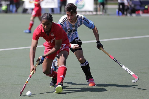 Photo: Trinidad and Tobago international Tariq Marcano (left) in action against Argentina in the Toronto 2016 Pan American Men's Junior Hockey Championships.
