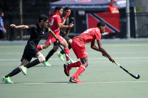 Photo: Trinidad and Tobago's Teague Marcano (right) in action at the Toronto 2016 Pan American Men's Junior Hockey Championships.