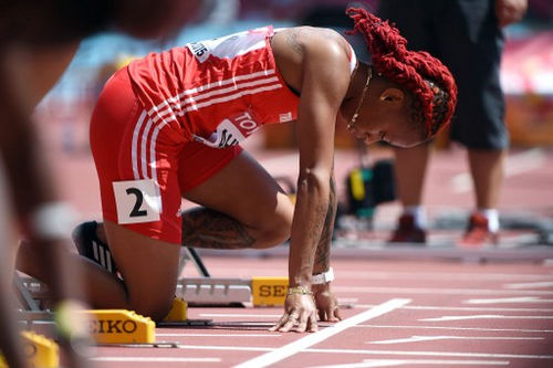 "Photo: Trinidad and Tobago's Michelle-Lee Ahye prepares to compete in the heats of the women's 100 metres event at the 2015 IAAF World Championships at the ""Bird's Nest"" National Stadium in Beijing on 23 August 2015. (Copyright Greg Baker/AFP 2016/Wired868)"