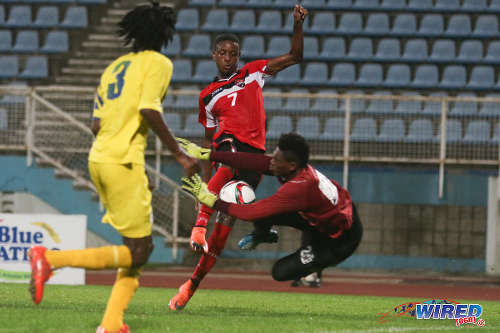 Photo: Trinidad and Tobago National Under-20 attacker Isaiah Hudson (centre) is denied by St Lucia goalkeeper Noah Didier during 2016 Caribbean Cup qualifying action at the Ato Boldon Stadium on 19 June 2016. The two teams played to a 1-1 draw. (Courtesy Chevaughn Christopher/Wired868)