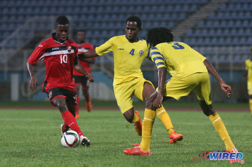 Photo: Trinidad and Tobago National Under-20 captain Jabari Mitchell (left) tries to keep the ball away from St Lucia midfielder Zachernus Simon during 2016 Caribbean Cup qualifying action at the Ato Boldon Stadium on 19 June 2016. The two teams played to a 1-1 draw. (Courtesy Chevaughn Christopher/Wired868)