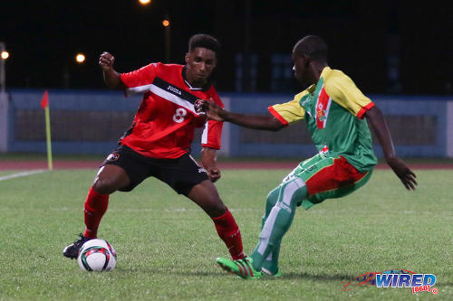 Photo: Trinidad and Tobago National Under-20 attacking midfielder Jared Dass (left) takes on a Guadeloupe player during Caribbean Under-20 Cup qualifiers at the Ato Boldon Stadium in Couva on 15 June 2016. T&T won 1-0. (Courtesy Chevaughn Christopher/Wired868)