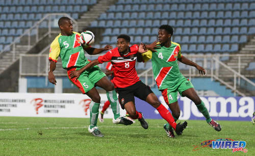 Photo: Trinidad and Tobago winger Jared Dass (centre) tussles for the ball with Guadeloupe defenders Loic Nuiro (left) and Hanane Nebot during Caribbean Under-20 Cup action at the Ato Boldon Stadium in 15 June 2016. Dass scored the winner as T&T won 1-0. (Courtesy Chevaughn Christopher/Wired868)