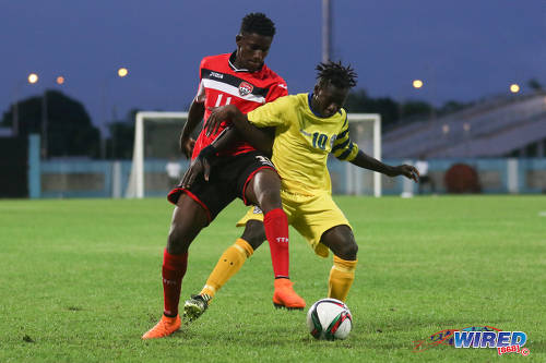 Photo: Trinidad and Tobago National Under-20 midfielder Kadeem Riley (left) tries to win the ball from St Lucia playmaker Cassius Joseph during 2016 Caribbean Cup qualifying action at the Ato Boldon Stadium on 19 June 2016. The two teams played to a 1-1 draw. (Courtesy Chevaughn Christopher/Wired868)