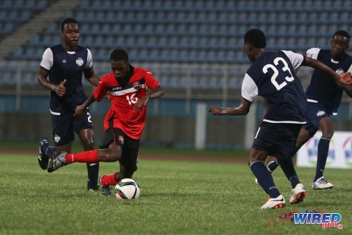 Photo: Trinidad and Tobago National Under-20 midfielder Micah Lansiquot (centre) takes on the Turks and Caicos defence during Caribbean Cup qualifying action at the Ato Boldon Stadium on 17 June 2016. T&T won 11-0. (Courtesy Chevaughn Christopher/Wired868)