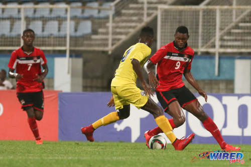 Photo: Central FC and Trinidad and Tobago National Under-20 striker Nicholas Dillon (right) takes on St Lucia defender Melvin Doxilly during 2016 Caribbean Cup qualifying action at the Ato Boldon Stadium on 19 June 2016. The two teams played to a 1-1 draw. (Courtesy Chevaughn Christopher/Wired868)
