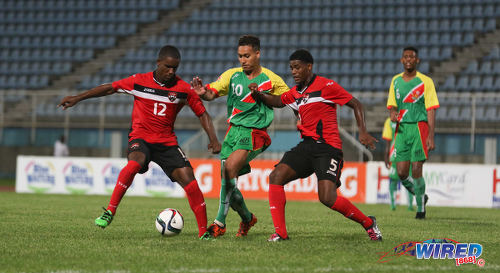 Photo: Guadeloupe Under-20 midfielder Yvann Macon (centre) tries to find a way past Trinidad and Tobago players Shane Sandy (left) and Taryk Sampson during Caribbean Under-20 Cup qualifiers at the Ato Boldon Stadium in Couva on 15 June 2016. T&T won 1-0. (Courtesy Chevaughn Christopher/Wired868)