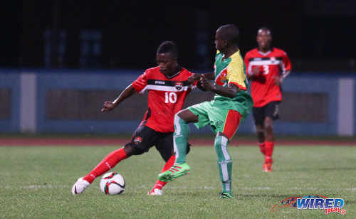 Photo: Trinidad and Tobago National Under-20 captain Jabari Mitchell (left) tries to work the ball past a Guadeloupe opponent during Caribbean Under-20 Cup qualifiers at the Ato Boldon Stadium in Couva on 15 June 2016. T&T won 1-0. (Courtesy Chevaughn Christopher/Wired868)