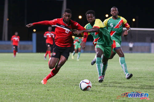 Photo: Trinidad and Tobago National Under-20 forward Nicholas Dillon (left) tries to power past Guadeloupe defender Hanane Nebot (centre) while his teammate Loic Nuiro looks on during Caribbean Under-20 Cup qualifiers at the Ato Boldon Stadium in Couva on 15 June 2016. T&T won 1-0. (Courtesy Chevaughn Christopher/Wired868)