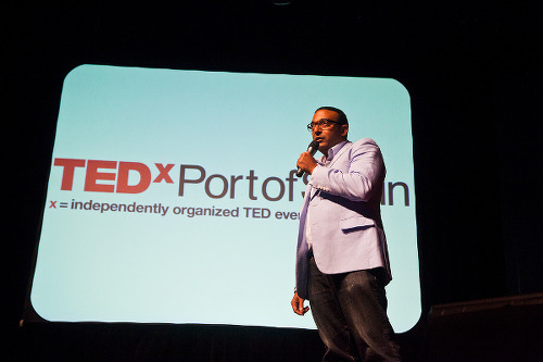 """Photo: A speaker offers """"the speech of his life"""" at TedX Port of Spain."""