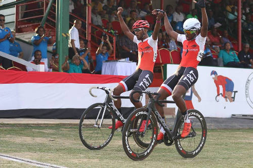 Photo: Trinidad and Tobago cyclist Varun Maharaj (left) celebrates during the 2015 Southern Games.