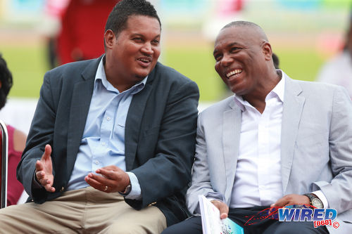 Photo: Trinidad and Tobago Sport Minister Darryl Smith (left) has a laugh with NAAA president Ephraim Serrette at the 2016 NAAA Open Championships at the Hasely Crawford Stadium, Port of Spain on 25 June 2016. (Courtesy Allan V Crane/Wired868)