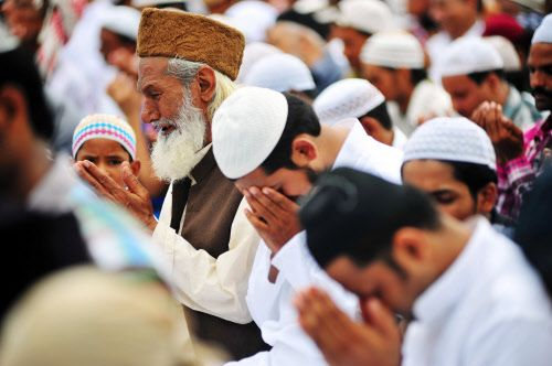 Photo: Muslim worshippers say prayers at Eid ul Fitr.