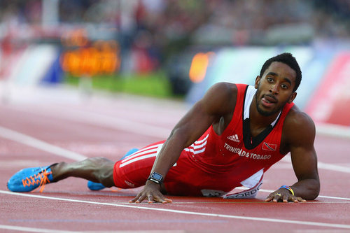 Photo: Trinidad and Tobago 40 metre hurdler Jehue Gordon lies on the track during the 2014 Commonwealth Games in Hamden, Scotland. (Copyright Zimbio)