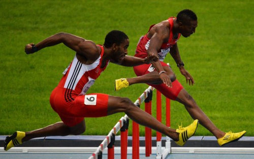 Photo: Trinidad and Tobago's Jehue Gordon (left) and United States' Michael Tinsley race to the line during the men's 400 metres hurdles final at the Moscow 2013 IAAF World Championships at the Luzhniki Stadium on 15 August 2013. (Copyright AFP 2016/Antonin Thuillier)