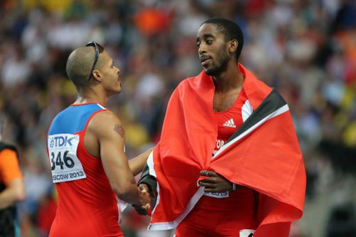 Photo: Dominican Republic's Felix Sanchez (left) shakes hands with Trinidad and Tobago's Jehue Gordon who won the men's 400 metres hurdles final at the Moscow 2013 IAAF World Championships at the Luzhniki Stadium on15 August 2013. (Copyright AFP2016/Yuri Kadobnov)