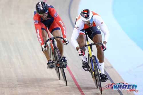 Photo: Trinidad and Tobago cyclist Njisane Phillip (right) sets the pace during battle with United States rider David Espinoza during the Toronto 2015 Pan American Games. (Courtesy Allan V Crane/CA Images/Wired868)