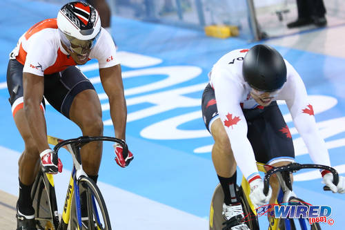 Photo: Trinidad and Tobago cyclist Njisane Phillip (right) chases Canada rider Hugo Barrett during the Toronto 2015 Pan American Games. (Courtesy Allan V Crane/CA Images/Wired868)