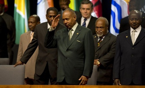 Photo: Late Trinidad and Tobago Prime Minister Patrick Augustus Mervyn Manning (centre) waves during the opening ceremony of the Commonwealth Heads of Government Meeting in Port of Spain, Trinidad and Tobago, on 27 November 2009. Britain's Queen Elizabeth II, the titular head of the Commonwealth, was to officially open the three-day summit. (Copyright AFP 2016/Luis Acosta)
