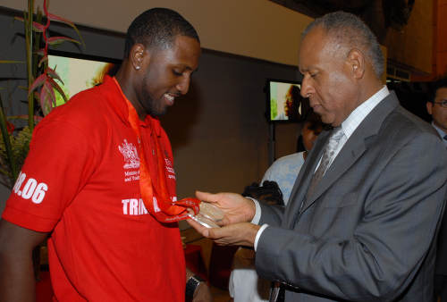 Photo: Then Trinidad and Tobago Prime Minister Patrick Manning (right) inspects sprinter Richard Thompson's silver medals after the Beijing 2008 Olympic Games. (Courtesy SPORTT)