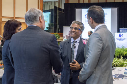Photo: Law Association of Trinidad and Tobago (LATT) president Reginald Armour SC (centre) meets and greets at the Transparency Institute anti-corruption conference on 8 March 2016. (Copyright Shaun Rambaran/forge.co.tt)