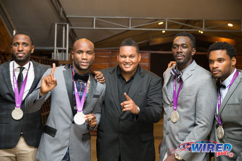 Photo: Trinidad and Tobago's London Olympics 4x100 metre relay team of (from left) Richard Thompson, Emmanuel Callender, Marc Burns and Keston Bledman pose with Sport Minister Darryl Smith (centre) in a ceremony at The Anchorage, Carenage  on 29 June 2016. (Courtesy Allan V Crane/CA Images/Wired868)