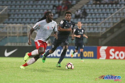 Photo: Central FC star forward Kenwyne Jones (left) tries to motor past Sporting Kansas City midfielder Soni Mustivar during CONCACAF Champions League action at the Ato Boldon Stadium in Couva on 16 August 2016. Both teams played to a 2-2 draw. (Courtesy Chevaughn Christopher/Wired868)