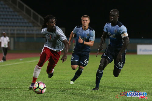 Photo: Central FC forward Jason Marcano (left) outpaces Vancouver Whitecaps defenders Brett Levis (centre) and captain Pa-Modou Kah during CONCACAF Champions League action on 2 August 2016. The Whitecaps won 1-0. (Courtesy Chevaughn Christopher/Wired868)