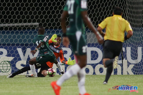 Photo: W Connection attacker Dimitrie Apai (left) is blocked by Honduras Progreso goalkeeper Woodrow West during CONCACAF Champions League action at the Ato Boldon Stadium, Couva on 25 August 2016. Connection and Progreso played to a 1-1 draw. (Courtesy Chevaughn Christopher/Wired868)