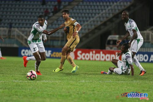Photo: W Connection players (from left) Jelani Peters, Gerrard Williams and Daneil Cyrus keep their eyes on the ball while Pumas UNAM captain Eduardo Herrera watches on during CONCACAF Champions League action in Couva on 3 August 2016. Pumas won 4-2. (Courtesy Chevaughn Christopher/Wired868)